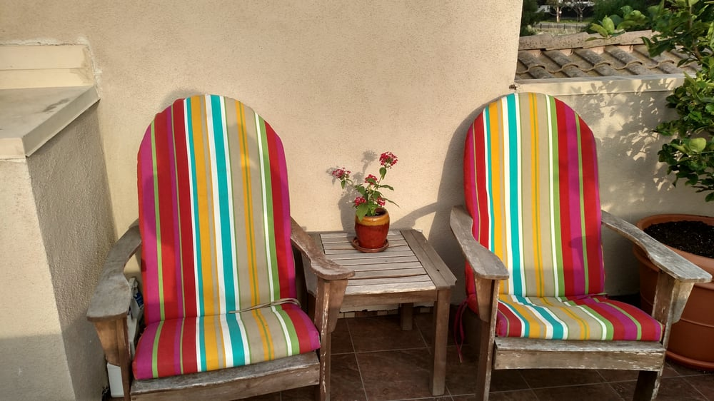 Old Comfy Adirondack Chairs With A Cheerful Plant And Cool Pot On The Table In Between Yelp