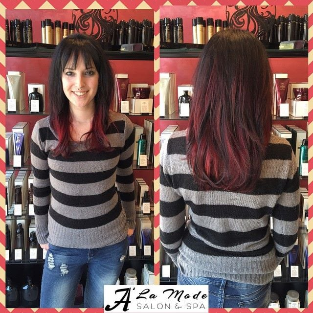 Red ombre highlights on a black base with a long layered for A la mode salon brooklyn