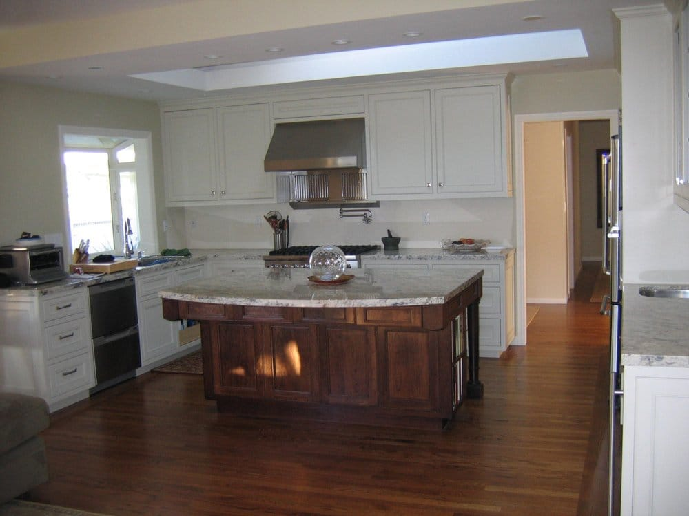 Sprayed on enamel finish on cabinets and hand stained and ...