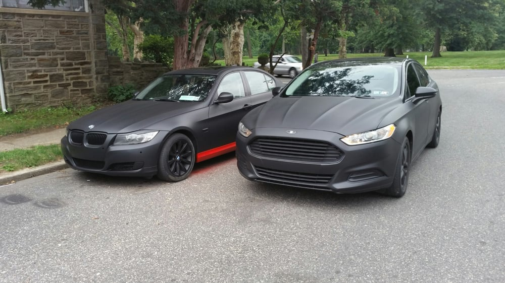 2 Matte Black Cars A Ford Fusion And A Bmw M3 With Red Plasti Dip Side Skirts Yelp