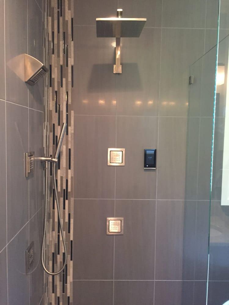 Kohler Shower System And Floor To Ceiling Tiles Including Deco Trim