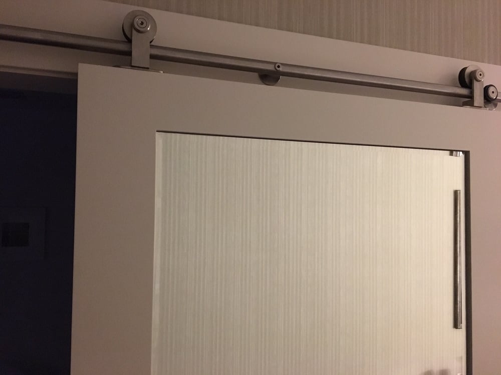 Clever Use Of Barn Door Slides To Close Either The Bathroom Or