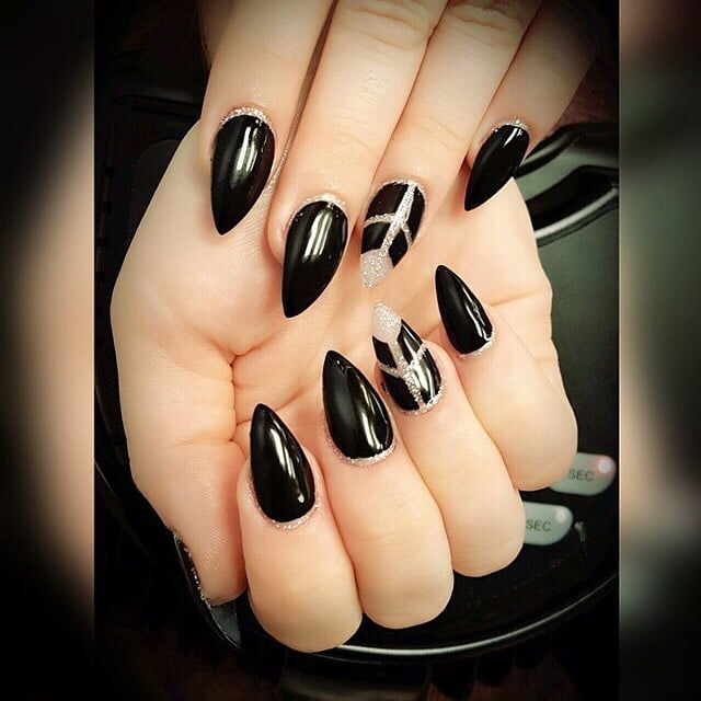 Stiletto nails by Andy Hai Dinh... Love my striking black nails and ...