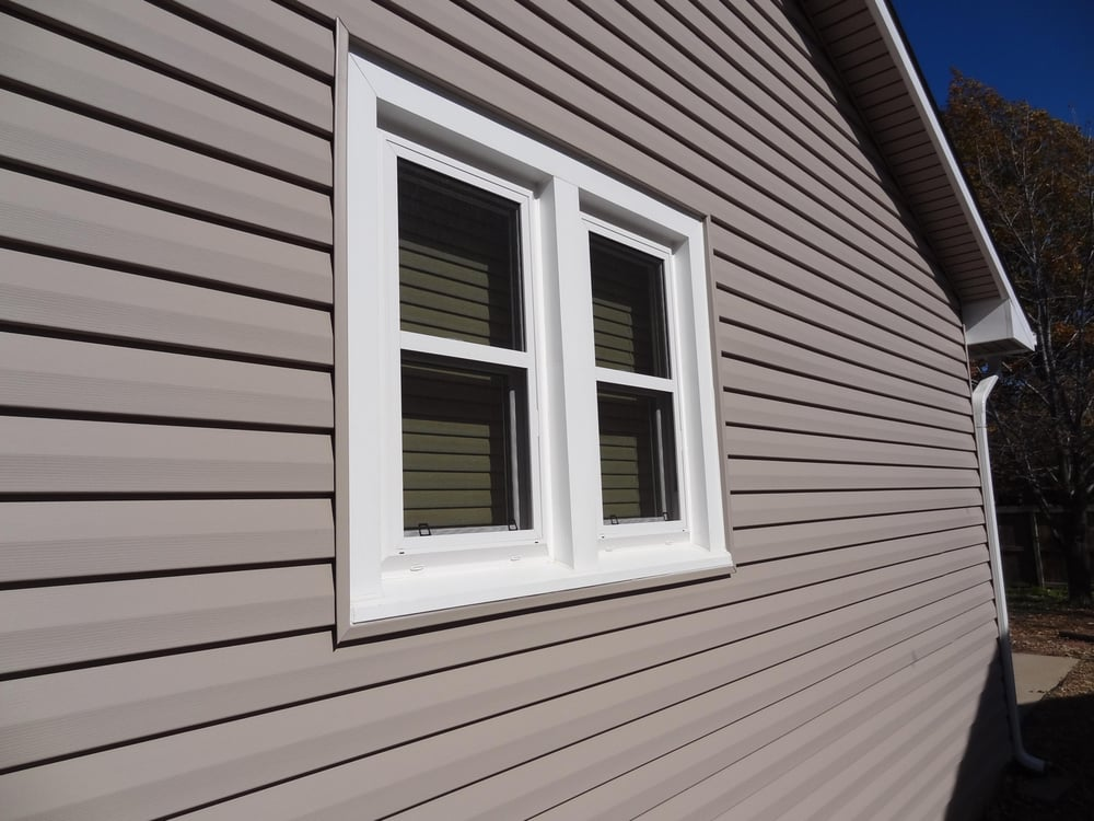 Dutch Lap Style Siding With House Trim Covered In Pvc