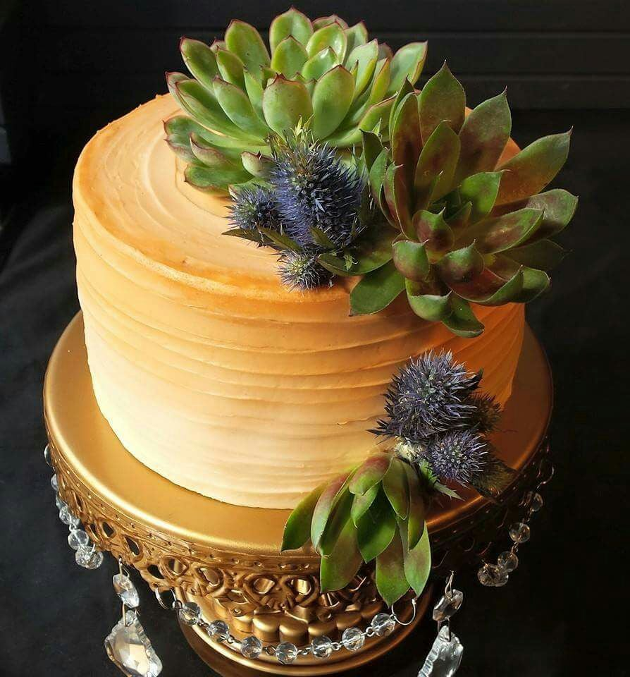 Copper ombre wedding cake with blue thistles and green succulents - Yelp