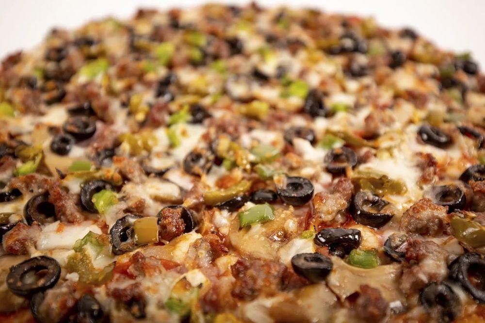 Johnny's Pizza House: 809 E Main St, Oak Grove, LA