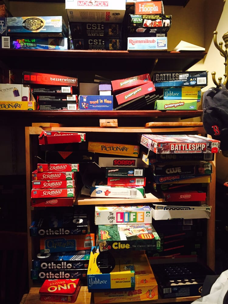 Bookshelf Filled With Board Games In The Back Of The Main