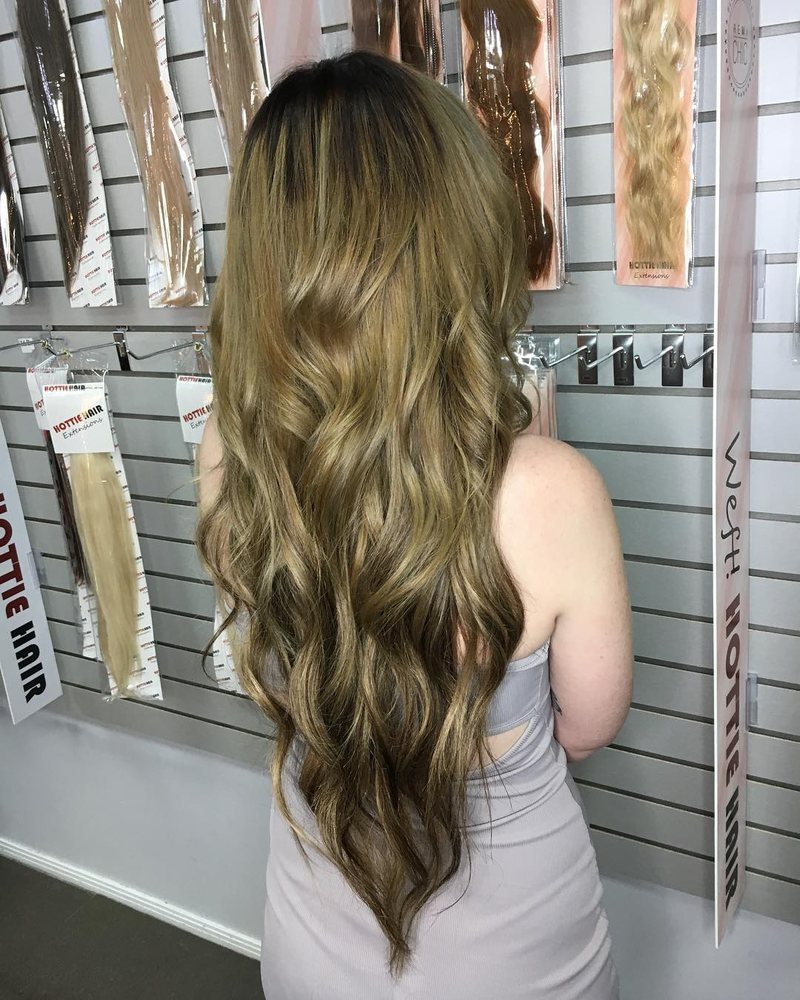 "26"" of remi chic tape ins by hottie hair this hair goes through a 15"