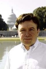 Claude L.