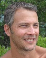 Travis R.